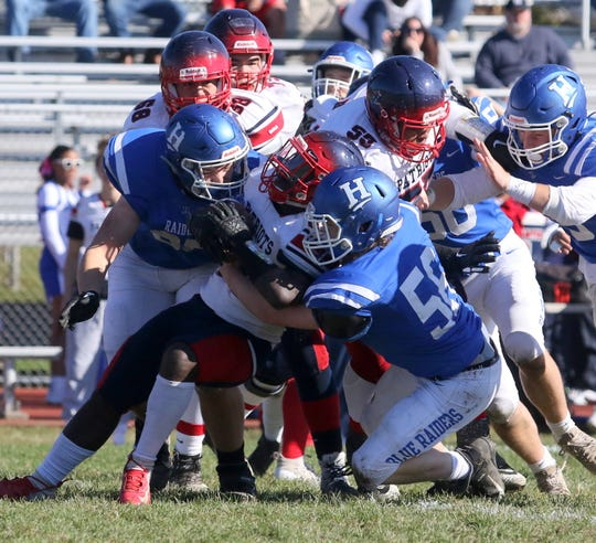 Horseheads' Gannon Johnston (left) and Aidan Legare combine to tackle Binghamton's Mose Hill during the Blue Raiders' 35-28 win Oct. 19, 2019 at Horseheads High School.