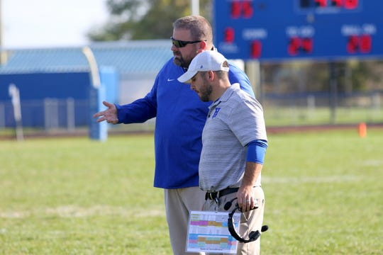 Horseheads head coach Kevin Hillman, right, talks to assistant Lou Condon Jr. during a 35-28 win over Binghamton on Oct. 19, 2019 at Horseheads High School.