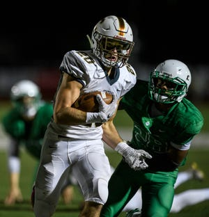 Central's Jacob Boberg (20) runs the ball in for a touchdown before North's Capoleton Presswood (28) can stop him during the third quarter at Bundrant Stadium in Evansville, Ind., Friday evening, Oct. 18, 2019.