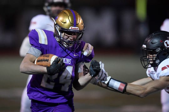 Fort Collins' Max Jones (24) is tackled in the third quarter of the game against Loveland at Rocky Mountain High School in Fort Collins, Colo. on Friday, Oct. 18, 2019.