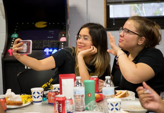 Alexia Hernandez, left, and Dilayne Saavedra take a selfie during Multicultural Day at Mariner High School on Oct. 10, 2019, in Cape Coral.