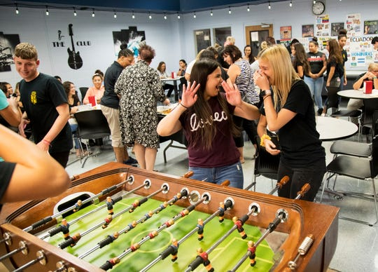 Lianet Noa, center, and Marla Orta celebrate scoring a point while playing foosball during Multicultural Day at Mariner High School on Oct. 10, 2019, in Cape Coral.