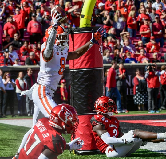Clemson wide receiver Justyn Ross (8) celebrates a touchdown near Louisville defensive back Anthony Johnson(27) during the second quarter at Cardinal Stadium in Louisville, Kentucky Saturday, October 19, 2019.