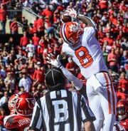 Clemson wide receiver Justyn Ross (8) catches a pass for a touchdown near Louisville defensive back Anthony Johnson(27) during the second quarter at Cardinal Stadium in Louisville, Kentucky Saturday, October 19, 2019.