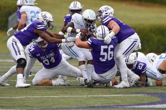 Furman's Cameron Coleman (56) Knox Kiernan, right, and Donavan Perryman tackle Citadel's Clay Harris during the first half. Furman hosted The Citadel in a SOCON football game Saturday, Oct. 19, 2019.