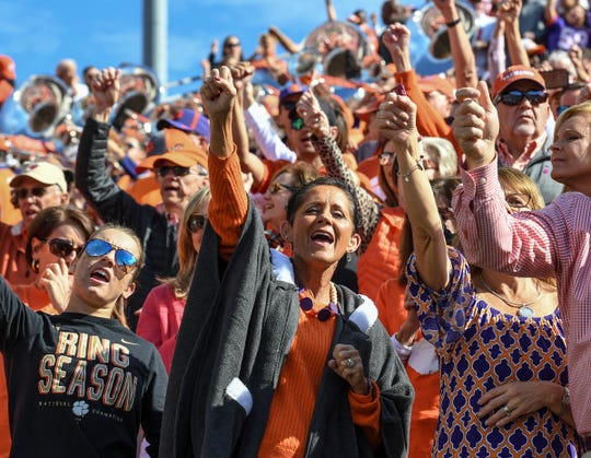 Clemson fan Liz Holmes of Anderson cheers with fellow Tiger fans before the game at Cardinal Stadium in Louisville, Kentucky Saturday, October 19, 2019.
