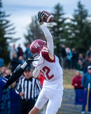 Fort Benton's William Ullery pulls down a pass in the endzone during Saturday's football game against Great Falls Central.