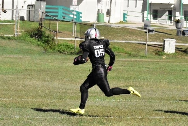 Kimberlyn Tupaz, a receiver and defensive back for the Raiders of the Guam Women's Tackle Football League, is shown in action during the recent season. She is one of five fooball players invited to a professional scouting combine in Las Vegas on Oct. 19.