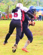 In these photos from 2012, defensive back Kimberlyn Tupaz has been part of the Guam Women's Tackle Football League since its inception that year.