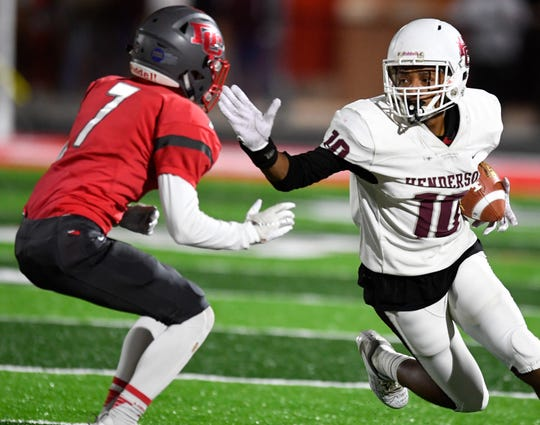 Henderson's Daymian Dixon (10) runs against defense from Daviess County's Bruno Espinosa (7) as the Henderson County Colonels play the Daviess County Panthers Friday evening at Reid Stadium, October 18, 2019.