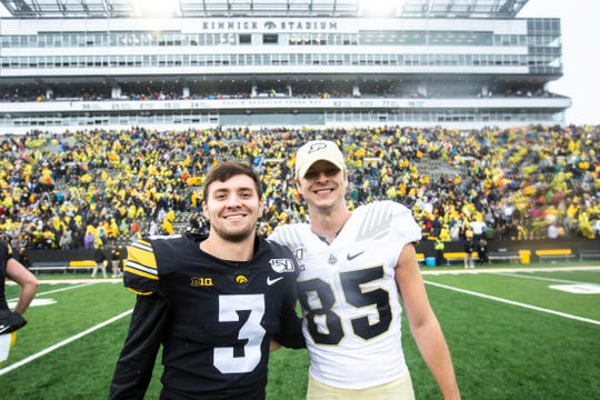 Iowa placekicker Keith Duncan (3) and Purdue kicker J.D. Dellinger (85) pose for a photo after a NCAA Big Ten Conference football game between the Iowa Hawkeyes and Purdue, Saturday, Oct., 19, 2019, at Kinnick Stadium in Iowa City, Iowa.