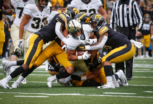 Members of the Iowa defense take down Purdue receiver Amad Anderson, Jr., in the second quarter on Saturday, Oct. 19, 2019, at Kinnick Stadium in Iowa City.