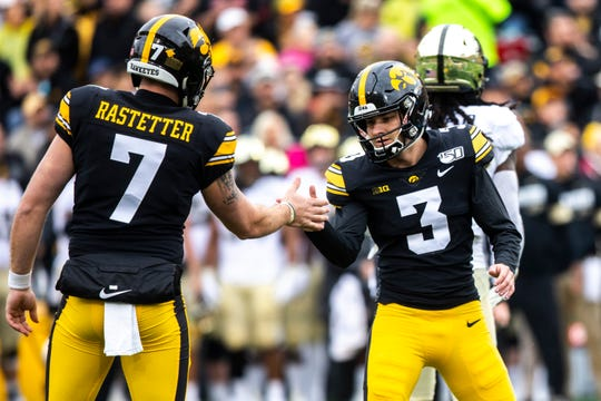 Iowa placekicker Keith Duncan (3) celebrates with Colten Rastetter (7) after kicking a field goal during a NCAA Big Ten Conference football game between the Iowa Hawkeyes and Purdue, Saturday, Oct., 19, 2019, at Kinnick Stadium in Iowa City, Iowa.