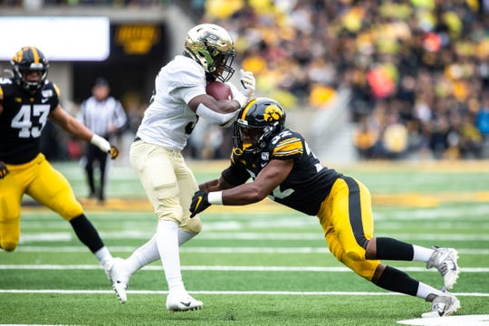 Iowa linebacker Djimon Colbert (32) tackles Purdue wide receiver David Bell (3) during a NCAA Big Ten Conference football game between the Iowa Hawkeyes and Purdue, Saturday, Oct., 19, 2019, at Kinnick Stadium in Iowa City, Iowa.