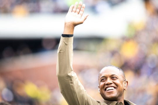 B.J. Armstrong waves to fans during a NCAA Big Ten Conference football game between the Iowa Hawkeyes and Purdue, Saturday, Oct., 19, 2019, at Kinnick Stadium in Iowa City, Iowa.