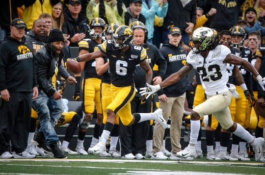 Junior Ihmir Smith-Marsette, here running after a catch vs. Purdue, has become the leader of Iowa's wide receiver group, even more so now that Brandon Smith is sidelined with a leg injury.