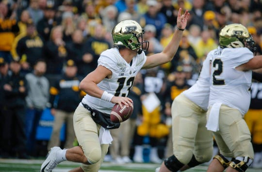 Purdue quarterback Jack Plummer looks for a receiver as the line holds Iowa's defense at bay on Saturday, Oct. 19, 2019, at Kinnick Stadium in Iowa City.
