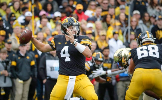 Iowa senior quarterback Nate Stanley fires a pass in the second quarter against Purdue on Saturday, Oct. 19, 2019, at Kinnick Stadium in Iowa City.