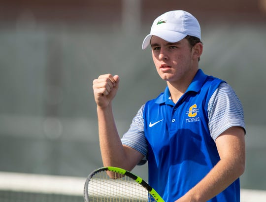Carmel High School senior Presley Thieneman, no. 1 singles, reacts during the 53rd Annual Boys' Team Tennis State Finals, Saturday, Oct. 19, 2019, at North Central High School between Carmel and North Central high schools.