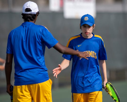 Carmel High School senior Uday Lomada, left, and junior Jones McNamar, react as they compete at no. 1 doubles, during the 53rd Annual Boys' Team Tennis State Finals, Saturday, Oct. 19, 2019, at North Central High School between Carmel and North Central high schools.