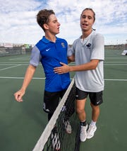 Carmel High School senior Presley Thieneman, no. 1 singles, meets North Central High School senior Ian Brady at the net after winning the match during the 53rd Annual Boys' Team Tennis State Finals, Saturday, Oct. 19, 2019, at North Central High School between Carmel and North Central high schools.