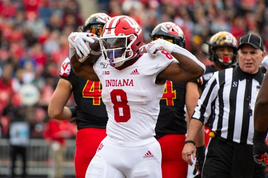 Indiana Hoosiers running back Stevie Scott III (8) reacts after scoring a first quarter touchdown of the game against the Maryland Terrapins at Capital One Field at Maryland Stadium.
