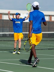 FILE – Carmel junior Jones McNamar, left, and Uday Lomada won the IHSAA individual doubles championship on Saturday.