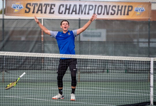 Carmel High School senior Presley Thieneman, no. 1 singles, reacts after winning his match during the 53rd Annual Boys' Team Tennis State Finals, Saturday, Oct. 19, 2019, at North Central High School between Carmel and North Central high schools.