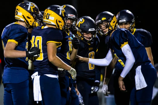 Iowa City Regina's Ashton Cook (6) calls out a play to teammates in a huddle during a Class 1A varsity football game, Friday, Oct., 18, 2019, at Regina Catholic High School in Iowa City, Iowa.