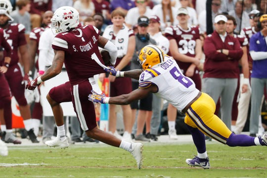 Mississippi State wide receiver Stephen Guidry (1) pulls away from LSU linebacker Patrick Queen (8) after receiving a pass during the first half of their NCAA college football game in Starkville, Miss., Saturday, Oct. 19, 2019. (AP Photo/Rogelio V. Solis)