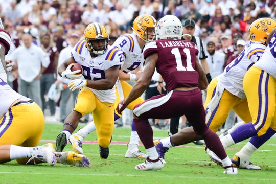 Oct 19, 2019; Starkville, MS, USA; Louisiana State Tigers  running back Clyde Edwards Helaire (22) caries the ball as Mississippi State Bulldogs safety Jaquarius Landrews (11) defends during the first quarter at Davis Wade Stadium. Mandatory Credit: Matt Bush-USA TODAY Sports