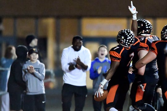 Powell's Jordan Brown (7) celebrates his touchdown against West on Friday, October 18, 2019. Powell won 21-20 in overtime.