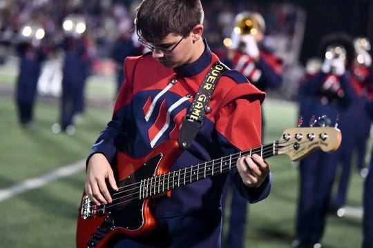 West High School band performing the halftime show during the football game between West and Powell on Friday, October 18, 2019.