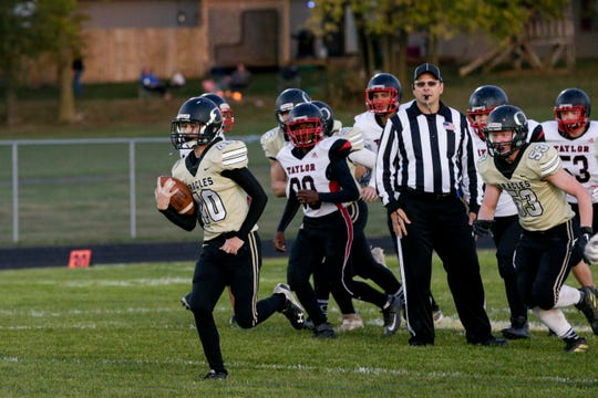 Delphi's Riley Lowder (40) runs the ball into the end zone to score honorary touchdown.
