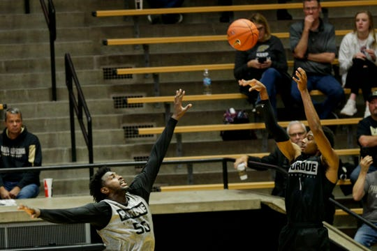 Purdue forward Aaron Wheeler (1) goes up for three over Purdue forward Trevion Williams (50) during scrimmage, Saturday, Oct. 19, 2019 at Mackey Arena in West Lafayette.