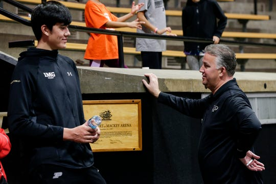 Purdue head coach Matt Painter talks with Zach Edey, 2020 recruiting class, Saturday, Oct. 19, 2019 at Mackey Arena in West Lafayette. Edey, 7-foot-3, received a scholarship offer from Purdue earlier this month.