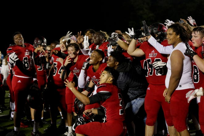 Lafayette Jeff players celebrate defeating Arsenal Tech, 55-14 to win the North Central Conference Championship, Friday, Oct. 18, 2019 in Lafayette. Lafayette Jeff won, 55-14.