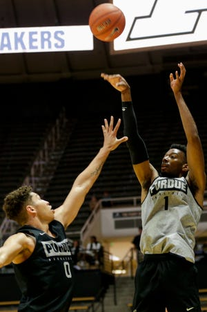 Purdue forward Aaron Wheeler (1) foes up for three over Purdue forward Mason Gillis (0) during a scrimmage, Saturday, Oct. 19, 2019 at Mackey Arena in West Lafayette.