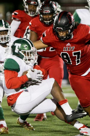 Lafayette Jeff defensive lineman Peyton Price (97) tackles the ball carrier during the third quarter of an IHSAA football game, Friday, Oct. 18, 2019 in Lafayette. Lafayette Jeff won, 55-14.