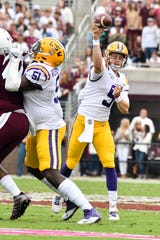 Oct 19, 2019; Starkville, MS, USA; Louisiana State Tigers  quarterback Joe Burrow (9) make a pass against the Mississippi State Bulldogs during the second quarter at Davis Wade Stadium. Mandatory Credit: Matt Bush-USA TODAY Sports