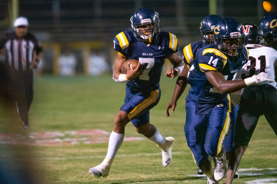 Carencro High's Kendrell Williams runs the ball during the play as the Carencro High Golden Bears take on the Northside High Vikings during their homecoming game on Friday, Oct. 18, 2019.