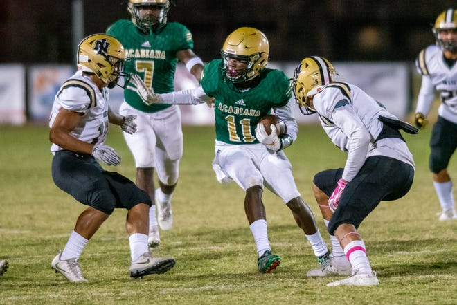 Acadiana High's Laterrance Welch moves the ball through the defense as the Acadiana High Wreckin' Rams take on the New Iberia High Yellowjackets during their homecoming game on Friday, Oct. 18, 2019.