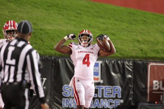 UL running back Raymond Calais. Jr. flexes after one of his two touchdown runs in a 37-20 win Thursday night at Arkansas State.