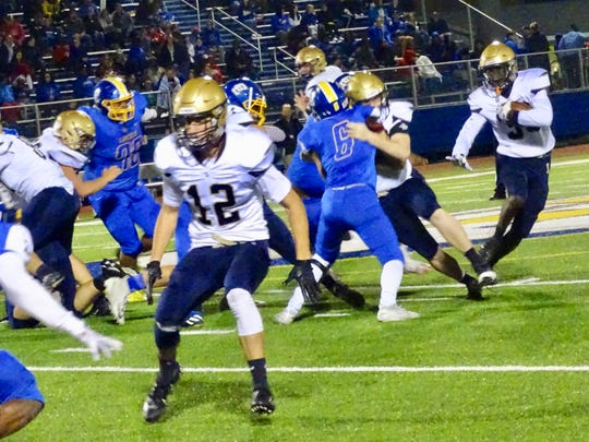 Lancaster's George Sherrick runs the ball as Casey Finck prepares to block in the Golden Gales' 28-25 loss to Gahanna Friday night.
