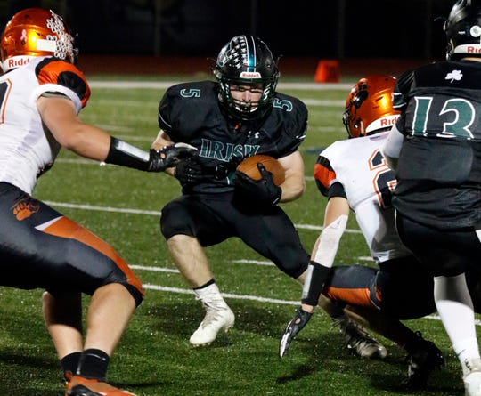 Fisher Catholic running back Nick Krooner look for running room during a game earlier this season against Lucas. The Irish will be making their second consecutive playoff appearance on Saturday.