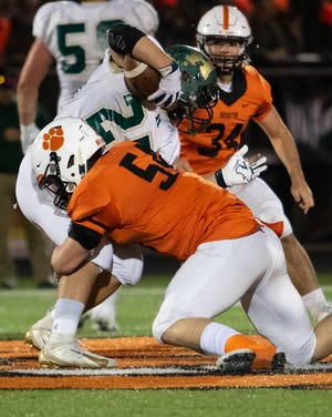 Brighton linebacker Cole Riddle tackles Howell's Jonah Schrock on Friday, Oct. 18, 2019.