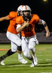 Brighton quarterback Colby Newburg ran nine times for 168 yards and two touchdowns in a 36-7 victory over Howell on Friday, Oct. 18, 2019.