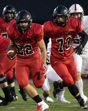 Pinckney's Sal Patierno (22) ran 12 times for 148 yards and four touchdowns in a 49-12 victory over Jackson.