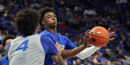 Kentucky's Ashton Hagans drives and then dishes past Nick Richards during the Blue-White scrimmage at Rupp Arena on Oct. 18, 2109