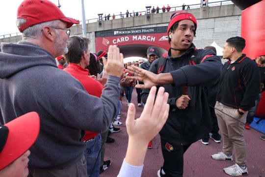 U of L player Dez Fitzpatrick greets fans during the Card March before their game against Clemson on Oct. 19, 2019 in Louisville, Ky.